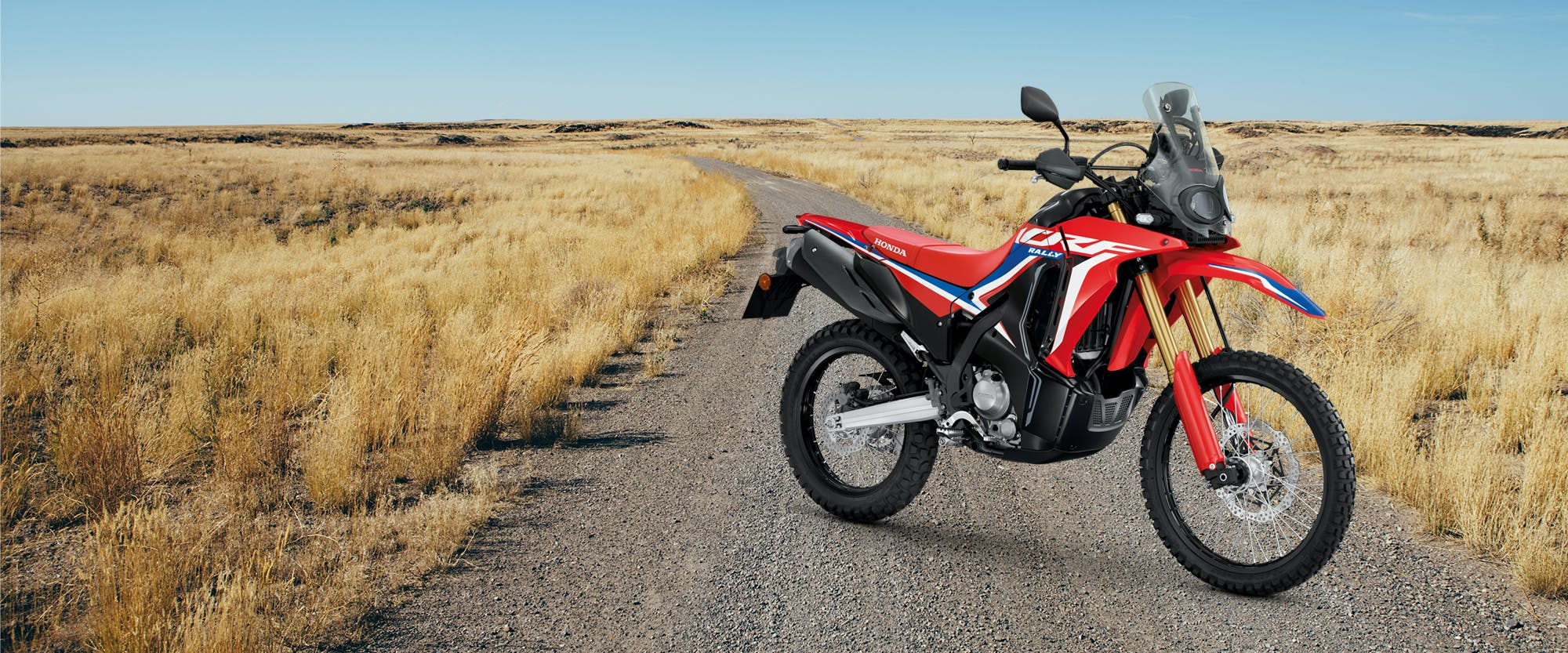 CRF300 Rally in extreme red colour, parked