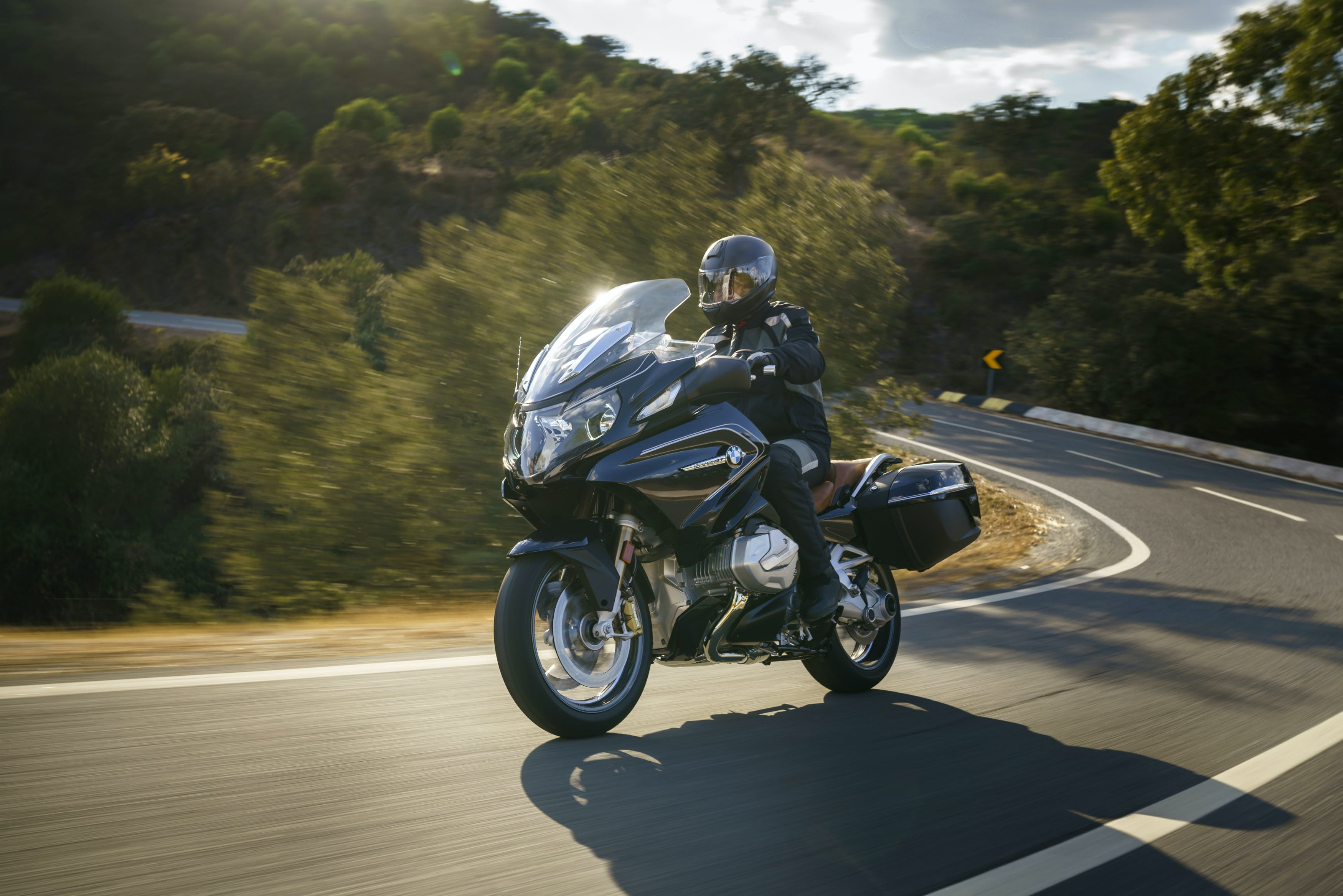 BMW R 1250 RT (SPORT) being ridden on the hill road