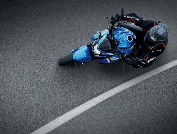 SUZUKI GSX-S750 being ridden on a road