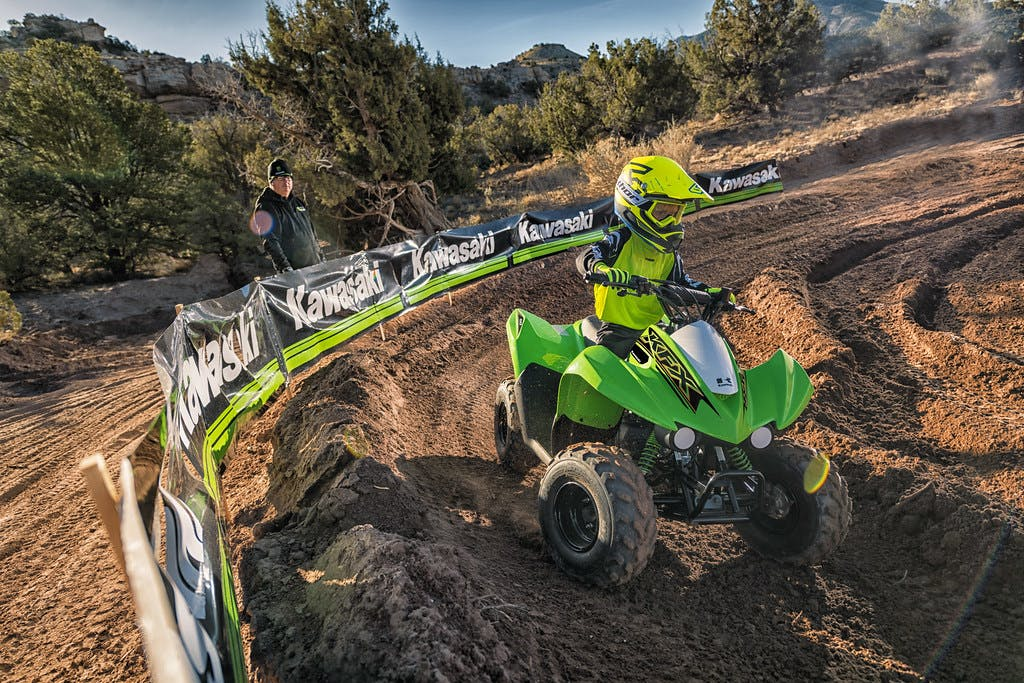 Kawasaki KFX50 in Green colour in action on dirt track