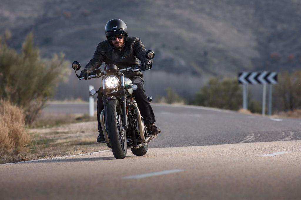 TRIUMPH BONNEVILLE BOBBER being ridden on the hill road