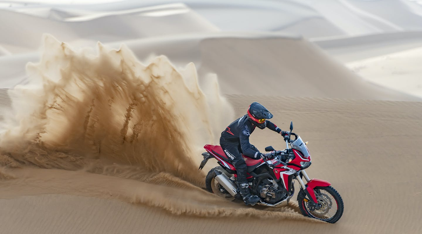 Honda Africa Twin in Grand Prix Red colour on off-road track