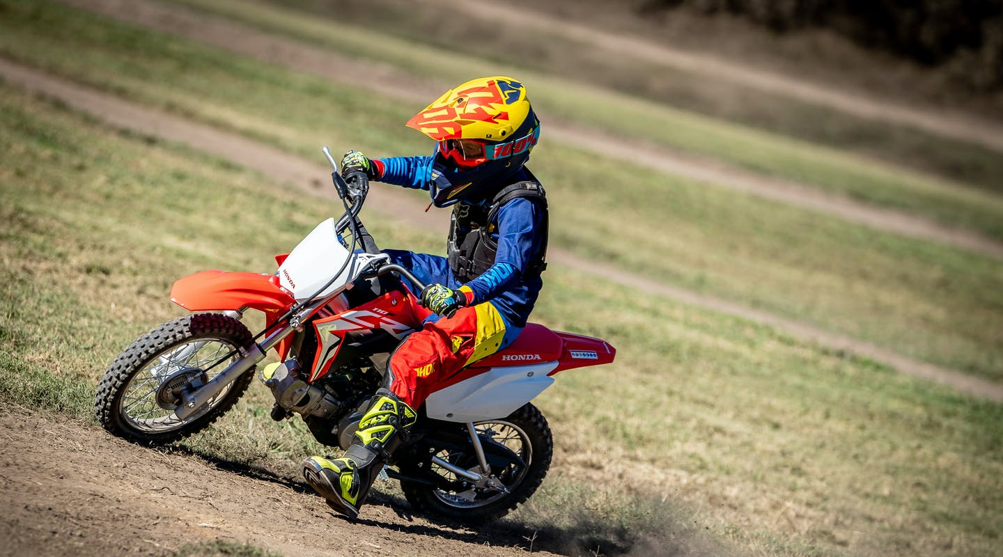 Honda CRF110F in extreme red colour on off road track