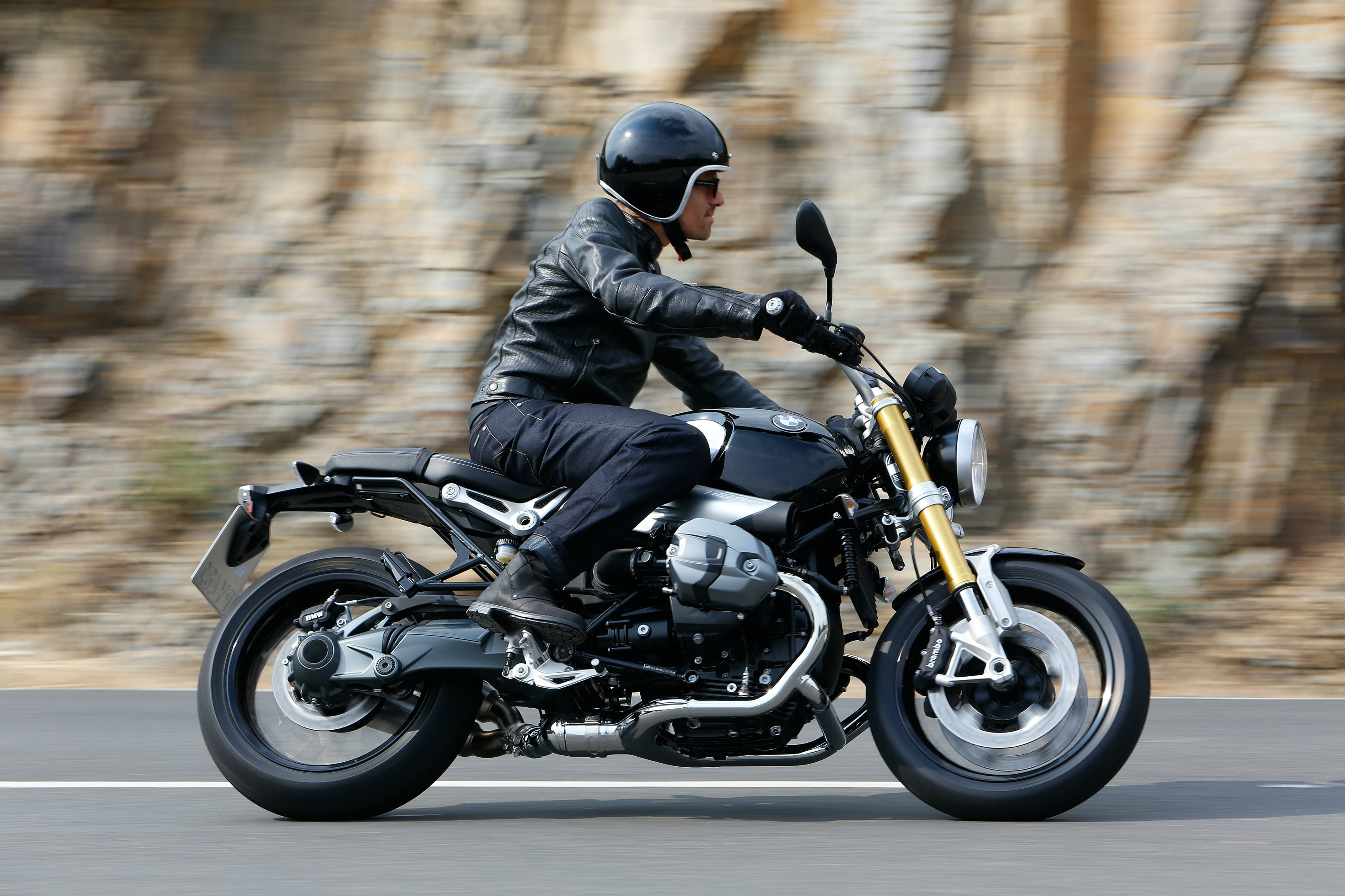 BMW  R NINET being ridden on a hill road