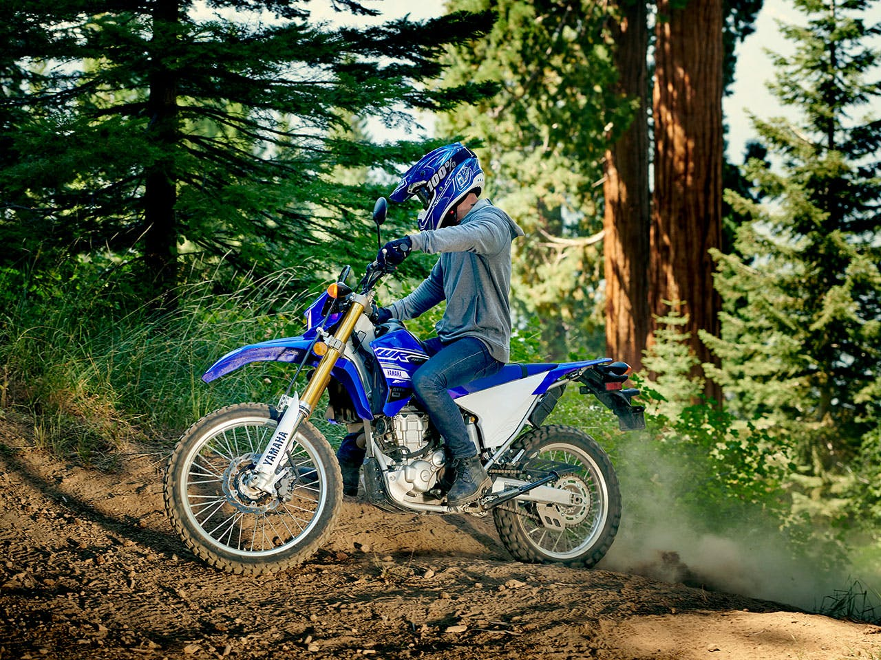 Yamaha ER250R in Team Yamaha Blue and white colour, being ridden off-track