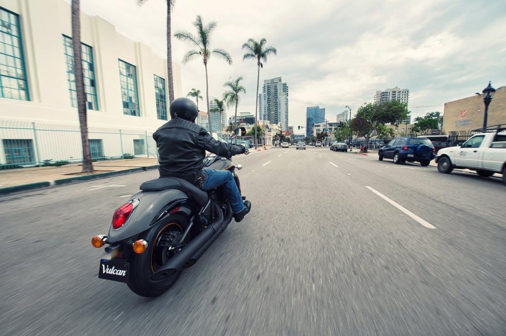 KAWASAKI VULCAN 900 CUSTOM being ridden on a road