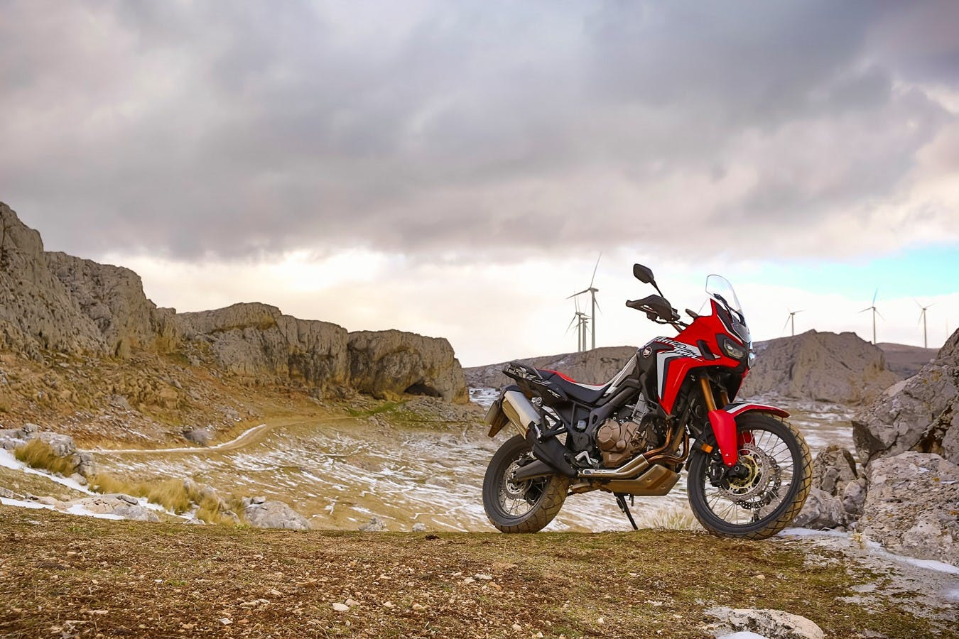 Honda 2018 africa twin in grand prix red  colour, parked on a hill