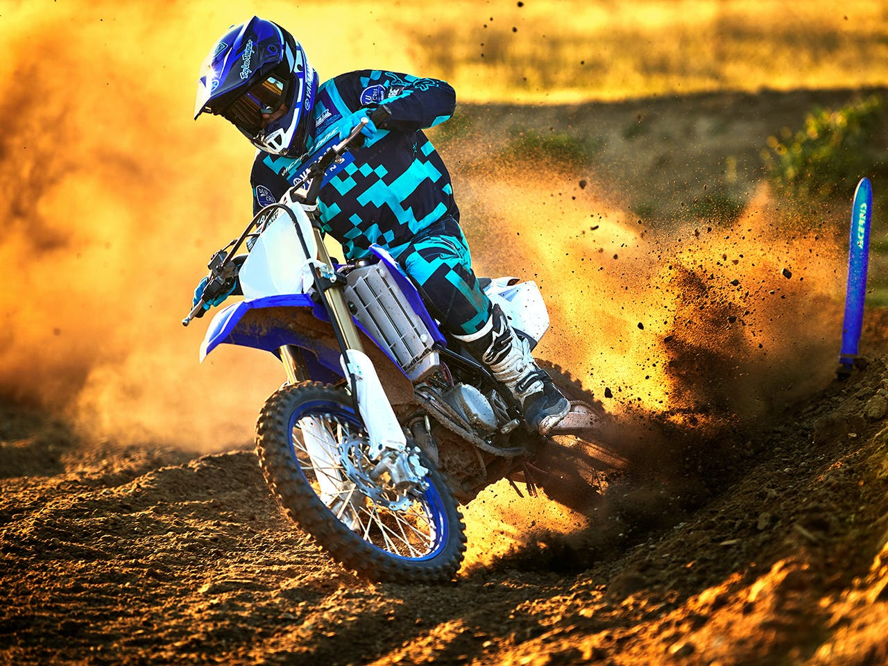 Yamaha YZ85 in team yamaha blue and white colour, being ridden off-track