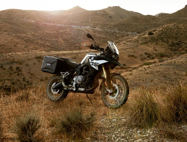 BMW F 850 GS Rallye motorcycle parked on a hill side
