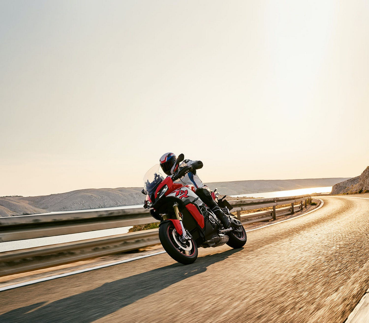 BMW S 1000 XR being ridden on the hill road