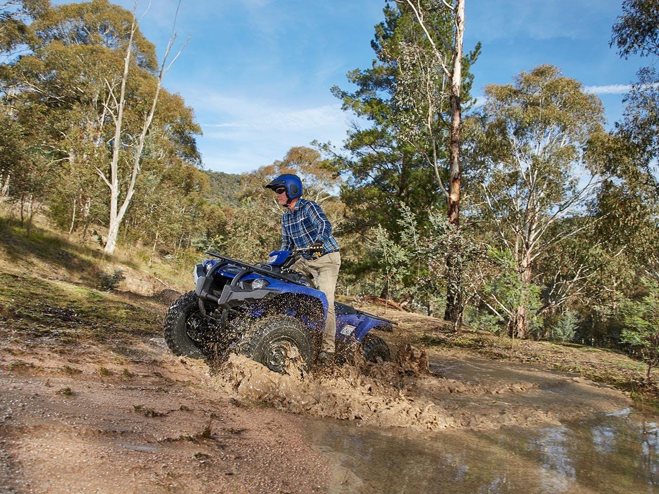 Yamaha Kodiak 450 EPS riding through muddy water