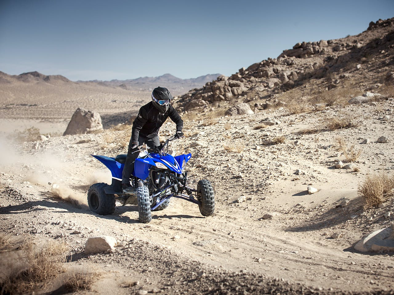Yamaha YFZ450R in team yamaha blue colour , being ridden in the desert