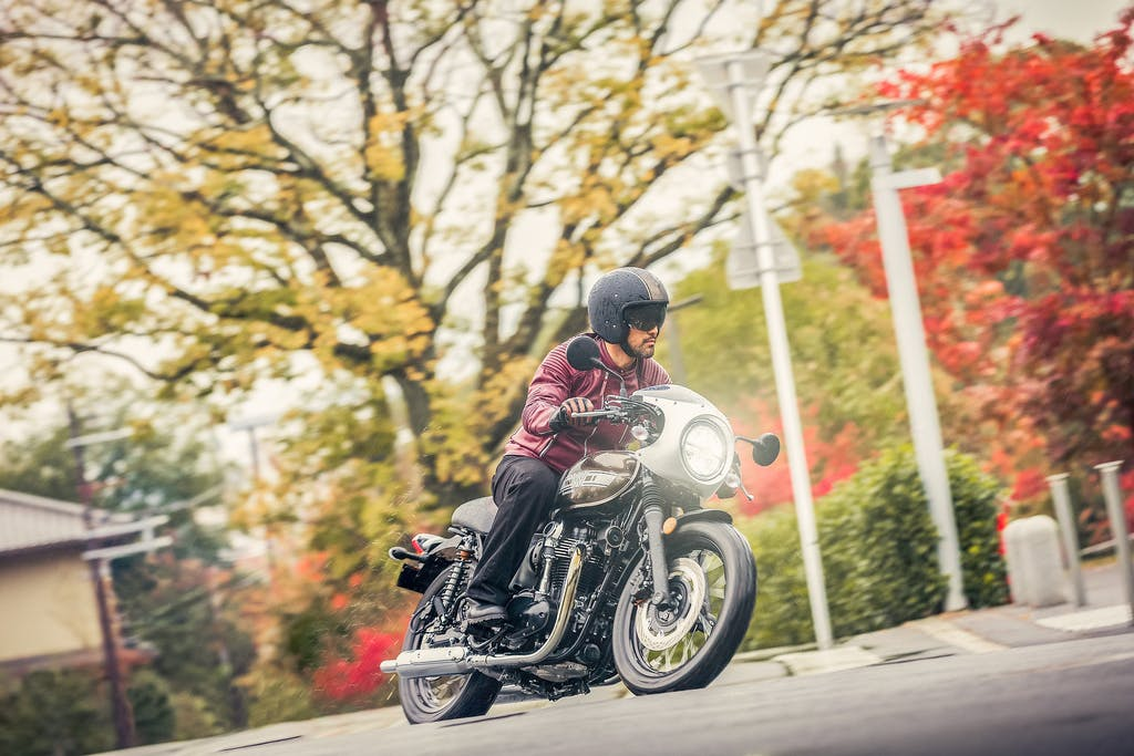 KAWASAKI W800 CAFE being ridden on a road