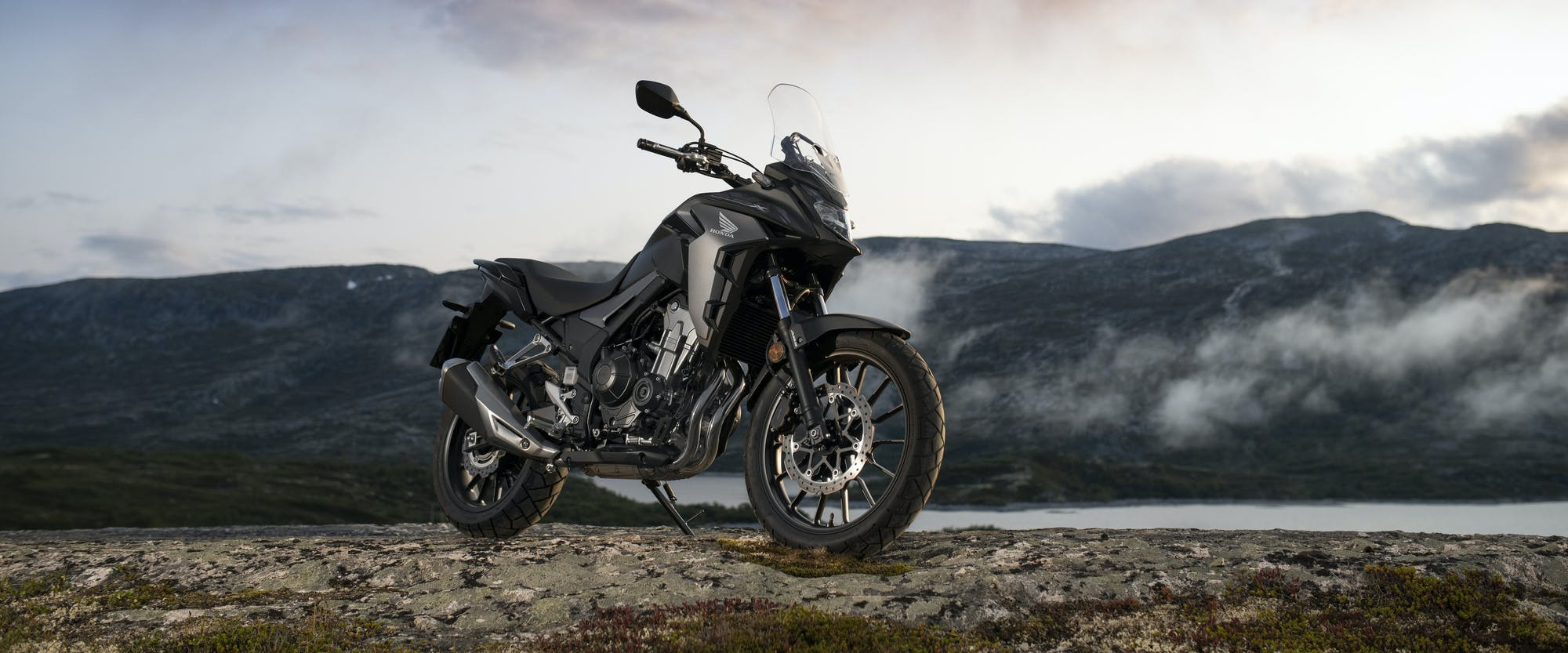 Honda CB500X in Matte Gunpowder Black Metallic colour, parked on off-road track