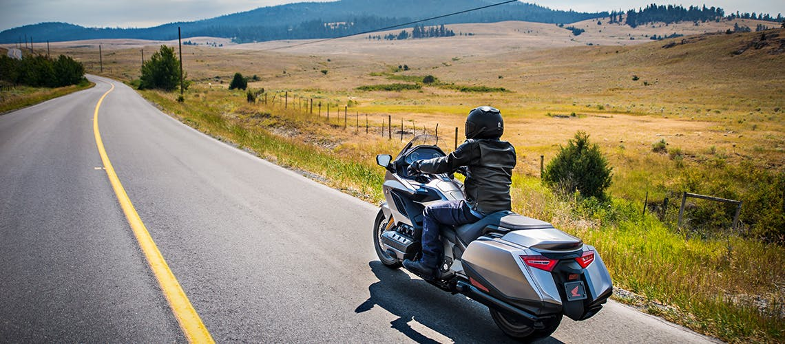 Honda 2018 Goldwing in matte majestic silver metallic colour, being ridden on the hill road