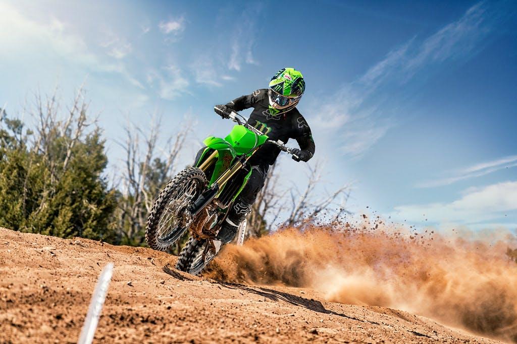 Kawasaki KX450 in Lime Green colour on dirt track