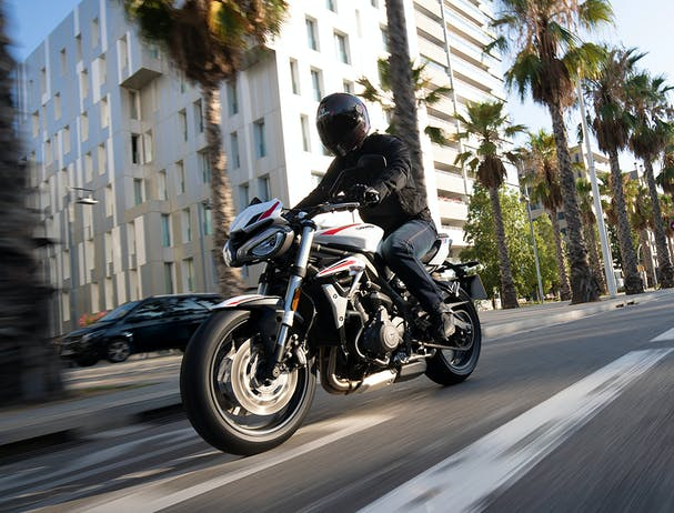 Triumph Street Triple S in crystal white colour on the road