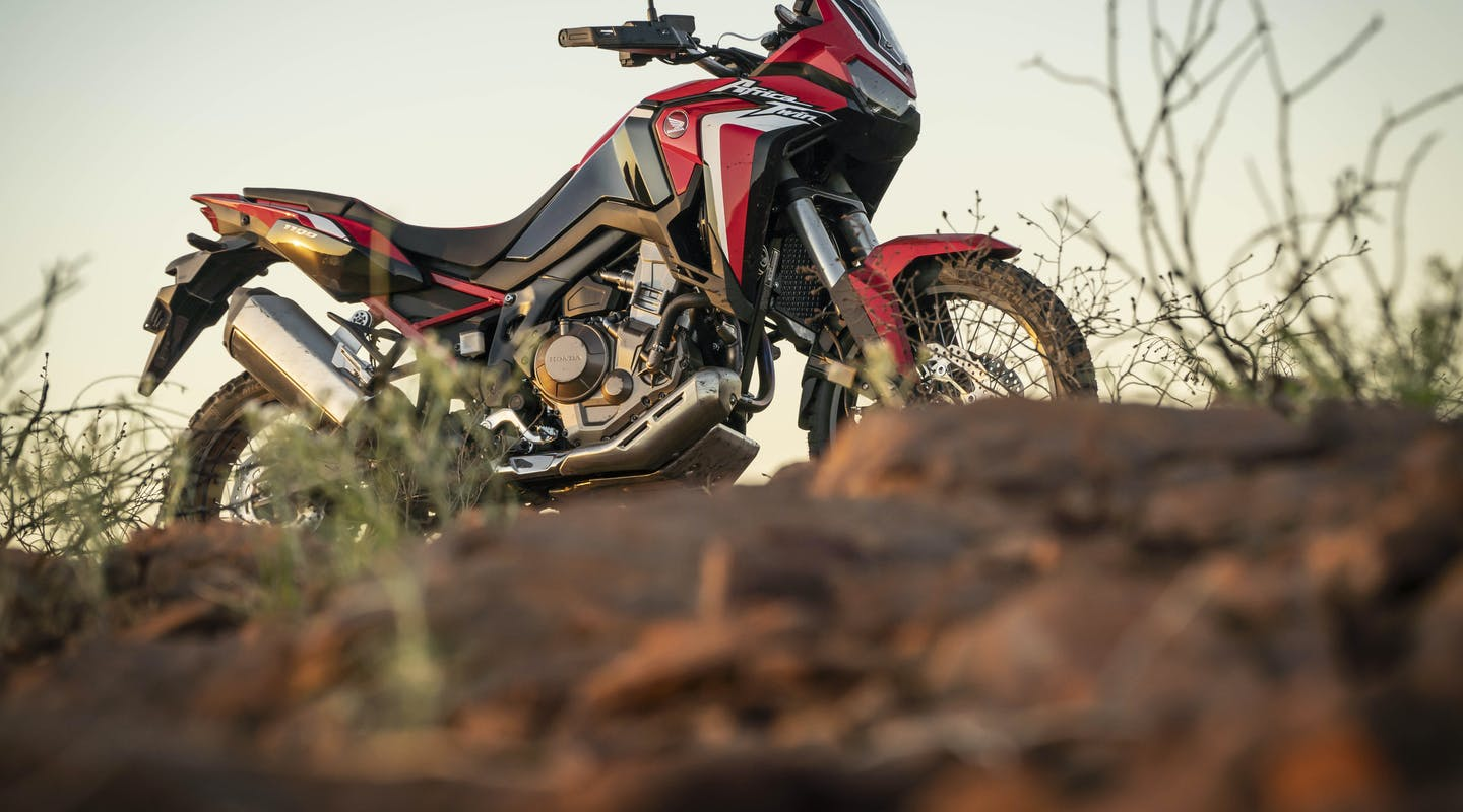 Honda Africa Twin in Grand Prix Red colour on the hilltop