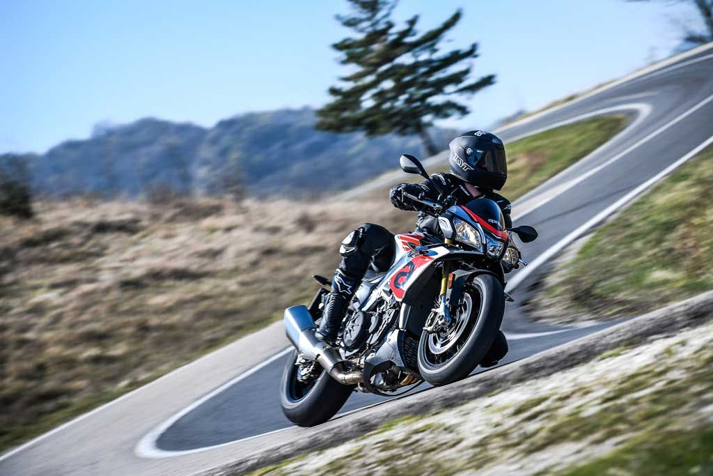 Aprilia Tuono V4 1100 RR, being ridden on the hil road