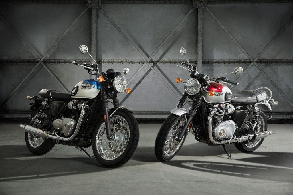 TRIUMPH THE BONNEVILLE T100 in fusion white and aegean and new england white and intense orange blue colour, parked