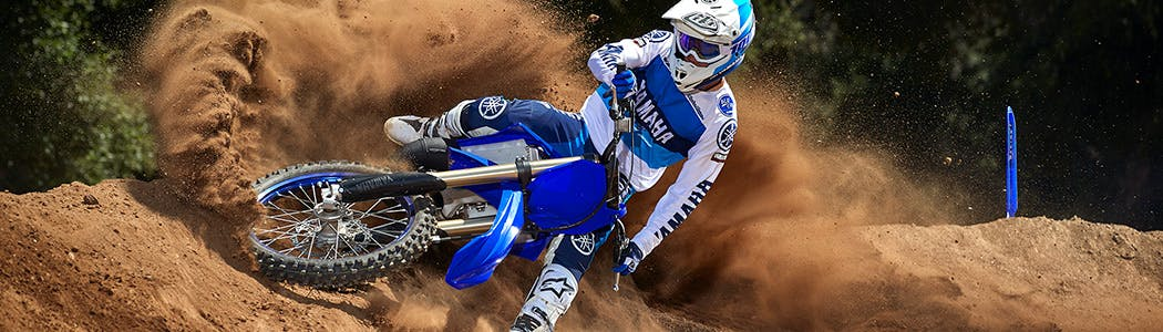 Yamaha YZ125 in team yamaha blue colour being ridden in off road track