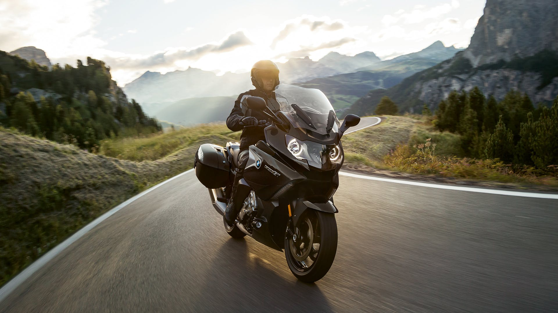 BMW K 1600 GT being ridden on the hill road