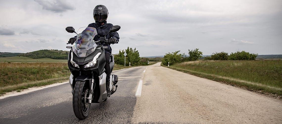Honda ADV150 in Matte Black Metallic colour on the road