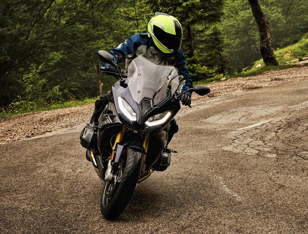 BMW R 1250 RS EXCLUSIVE being ridden on the hill road