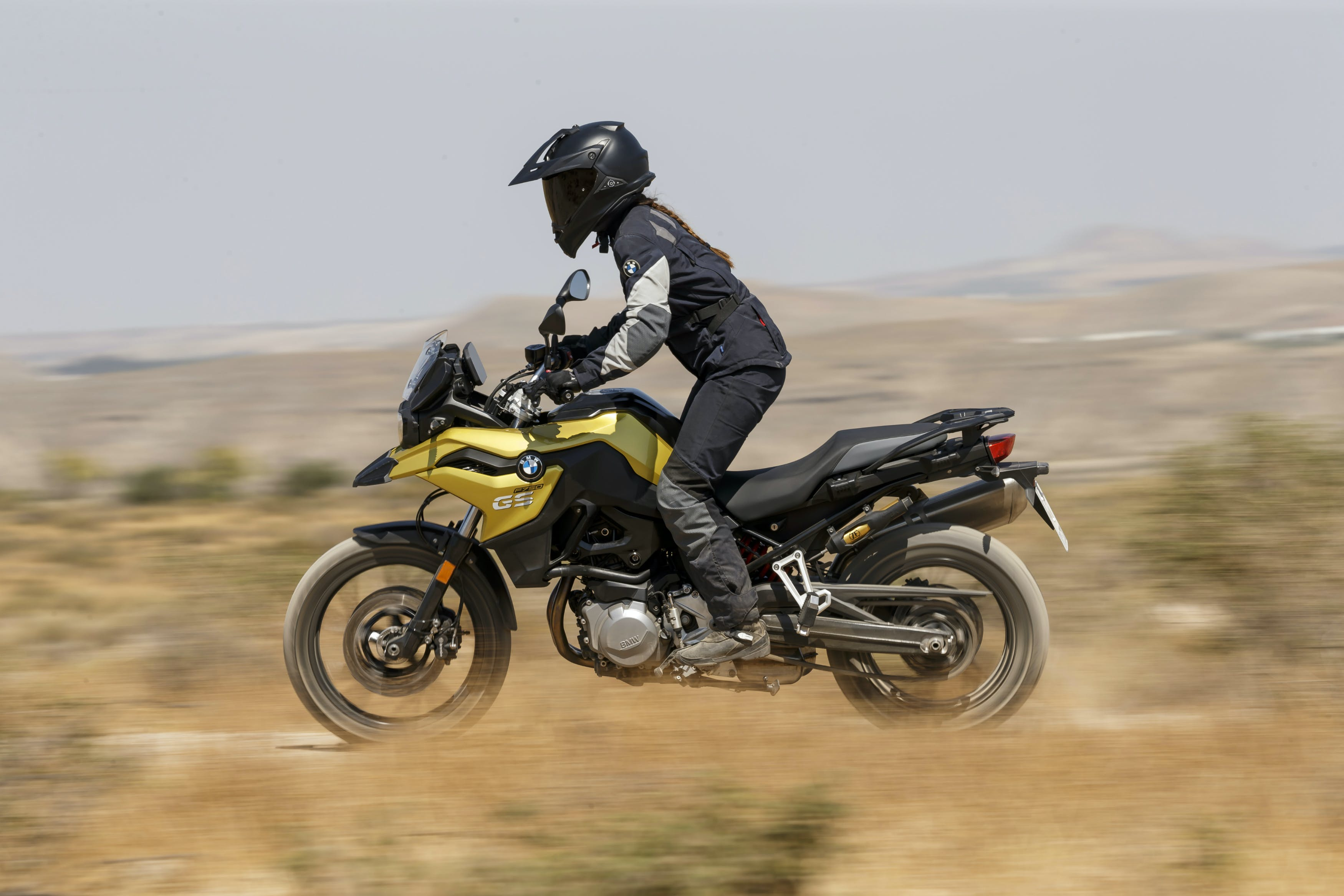 BMW F 750 GS TOUR motorcycle riding on a hill road