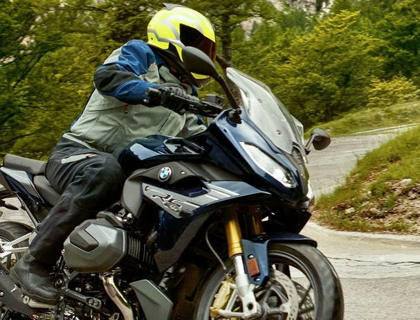 BMW R 1250 RS SPORT being ridden on the hill road