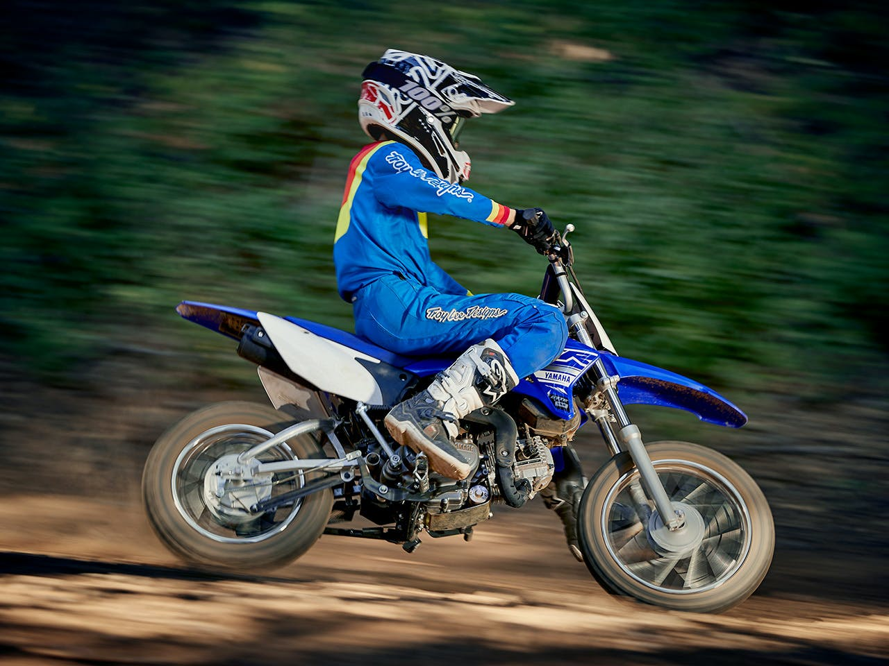 Yamaha TT-R110E in Team Yamaha Blue and White colour, being ridden off-track