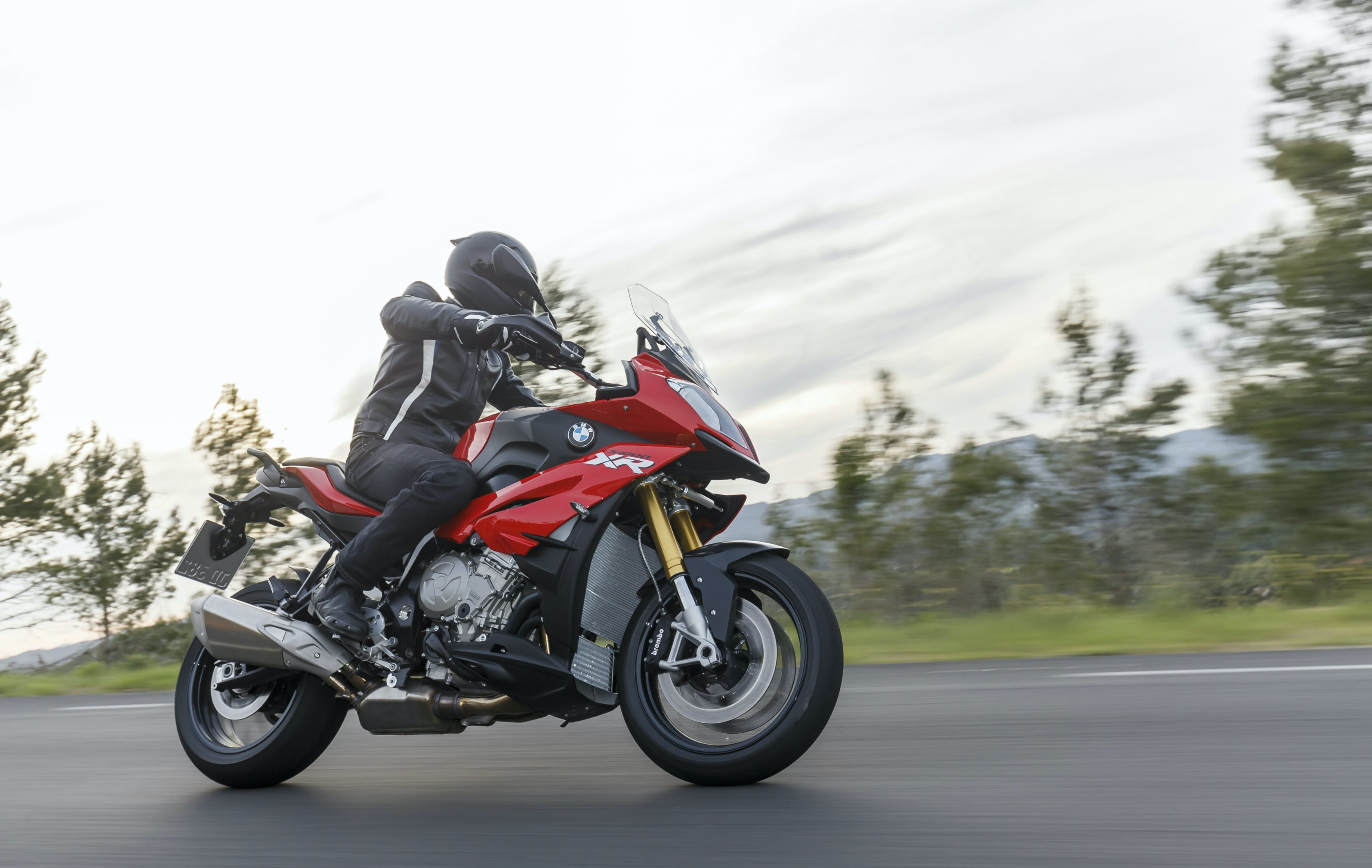 BMW S 1000 XR HP being ridden on the hill road
