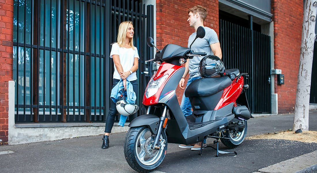 Kymco Agility 50 4T in ruby red colour, parked
