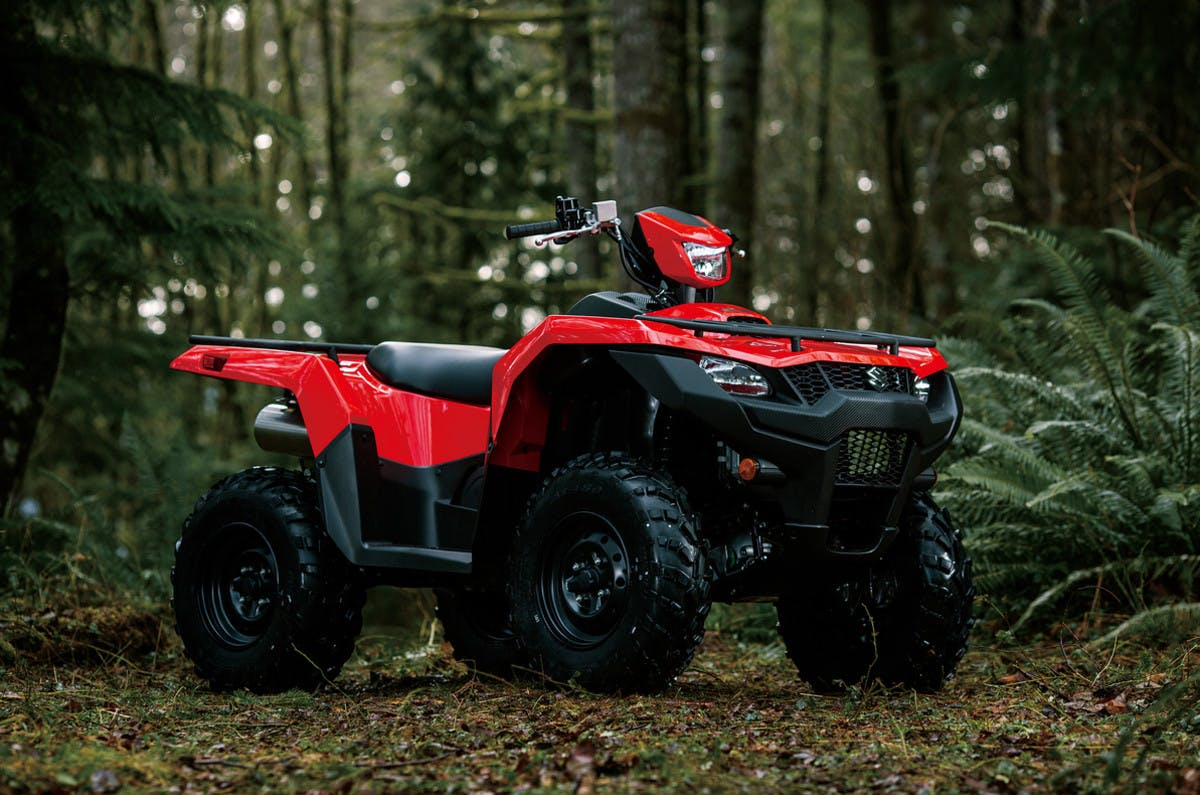 SUZUKI KINGQUAD 500AXI 4x4 parked in forest