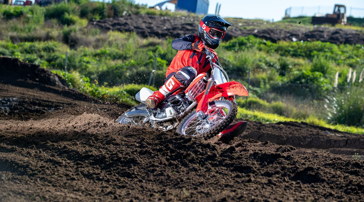 Honda CRF150R in extreme red colour on off road track