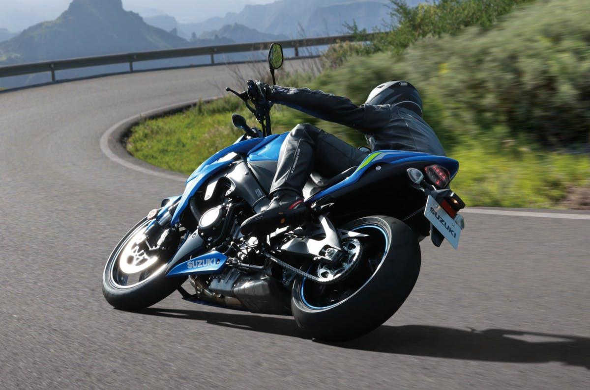 SUZUKI GSX-S1000 being ridden on a road