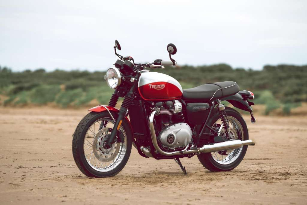 Triumph Bud Ekins T100 in red and white colour parked.