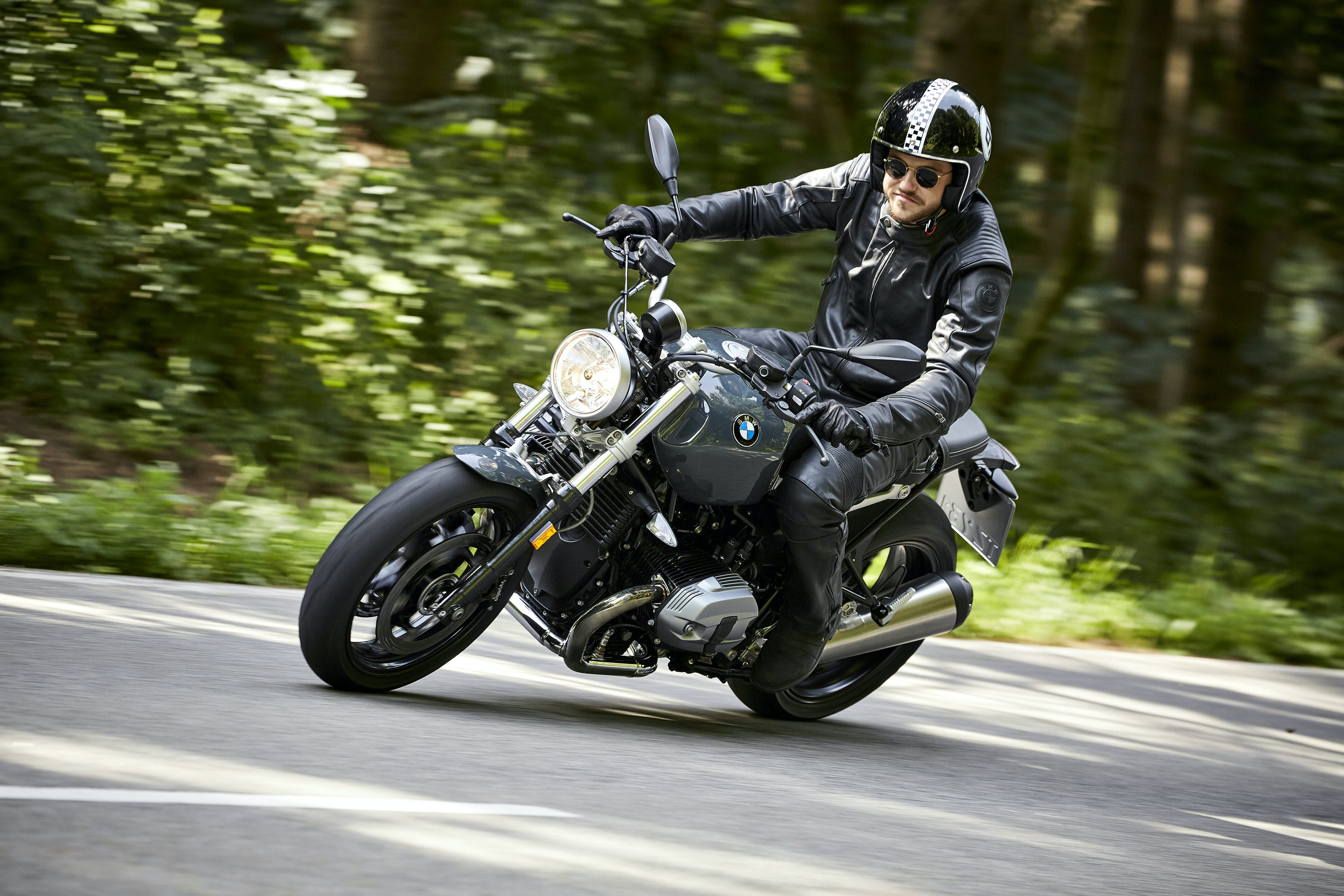 BMW R NINET PURE SPEZIAL being ridden on the road