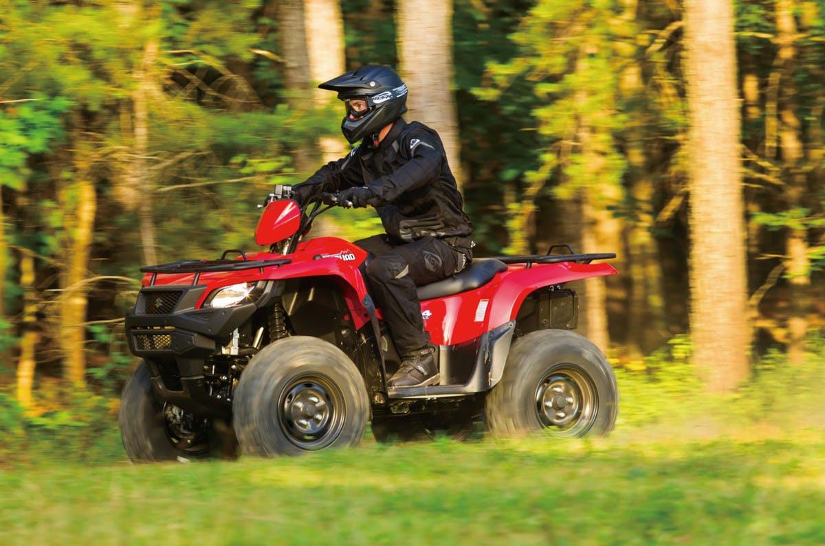 SUZUKI KINGQUAD 750AXI 4x4 PS being ridden on a farm