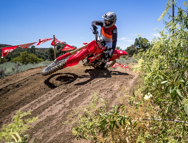 Honda CRF450R in extreme red colour being ridden on off road track