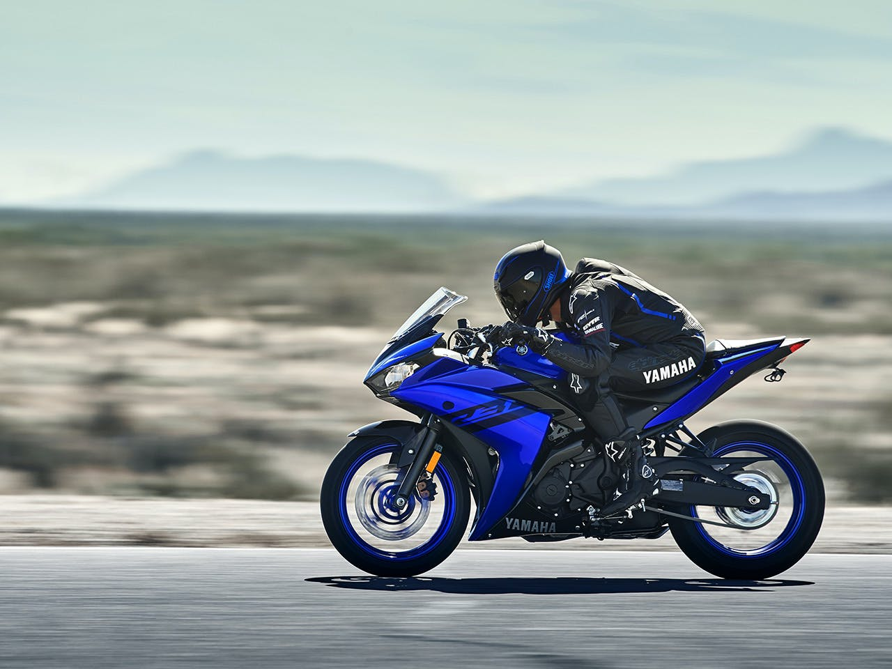 Yamaha YZF-R3 2018 being ridden on a road