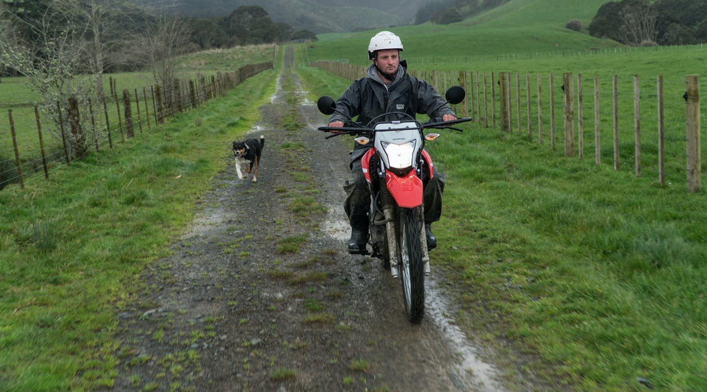 Honda XR190CT AG-XR in fighting red colour being ridden on the farm road