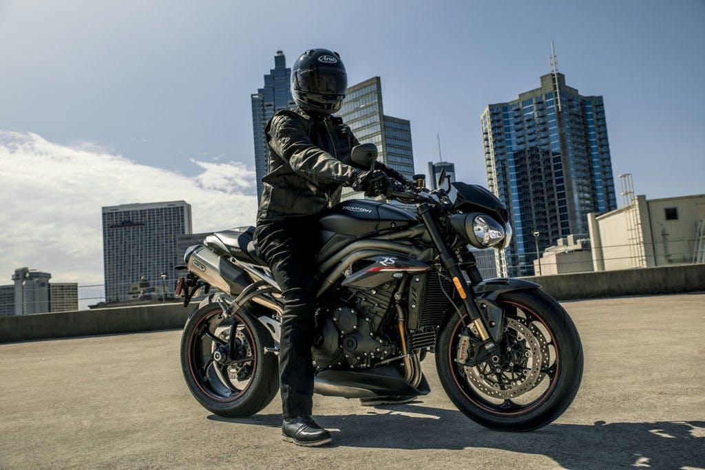 TRIUMPH SPEED TRIPLE S in matt jet black colour, with a rider