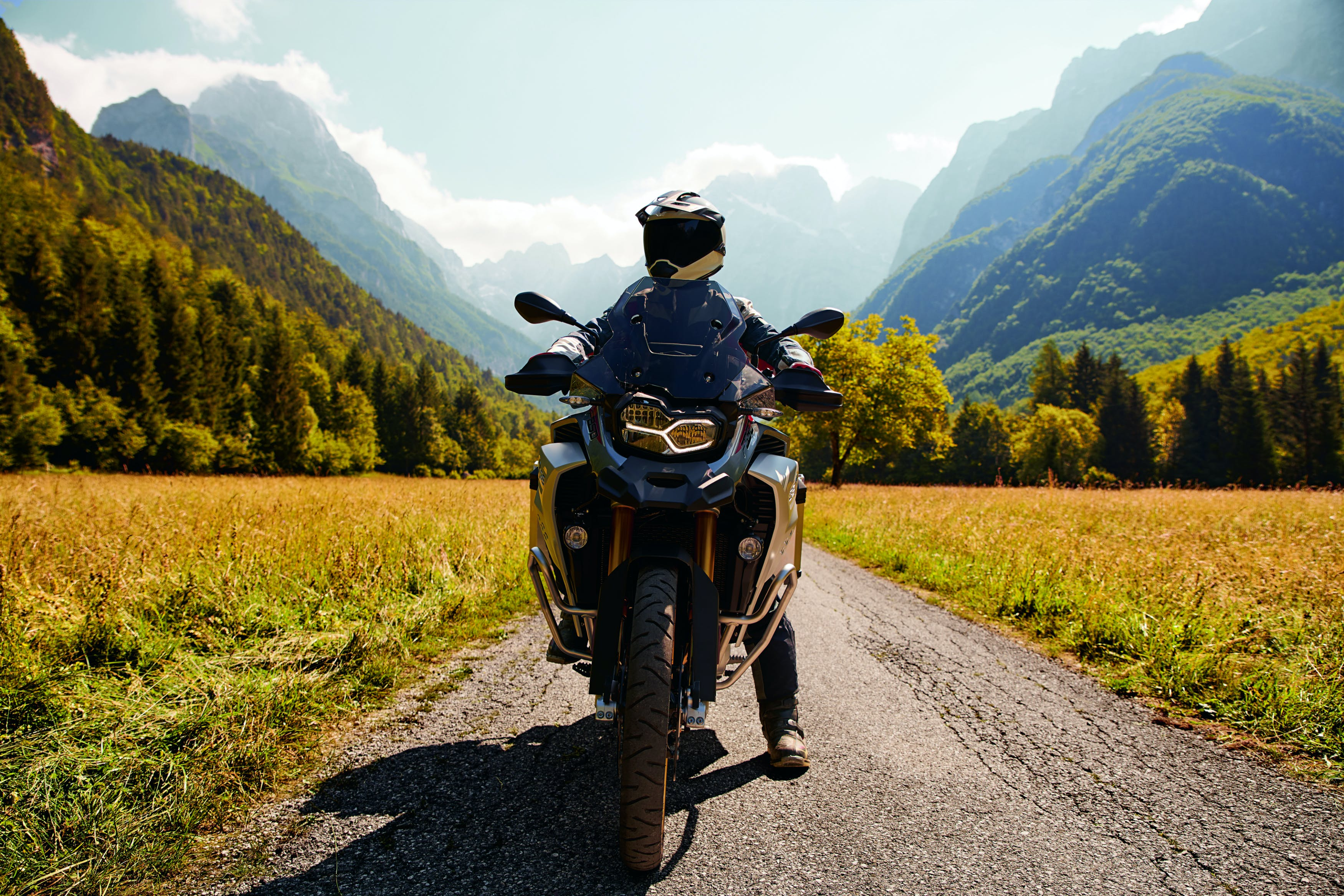BMW F 850 GS ADVENTURE RALLYE X motorcycle being ridden on a hill road