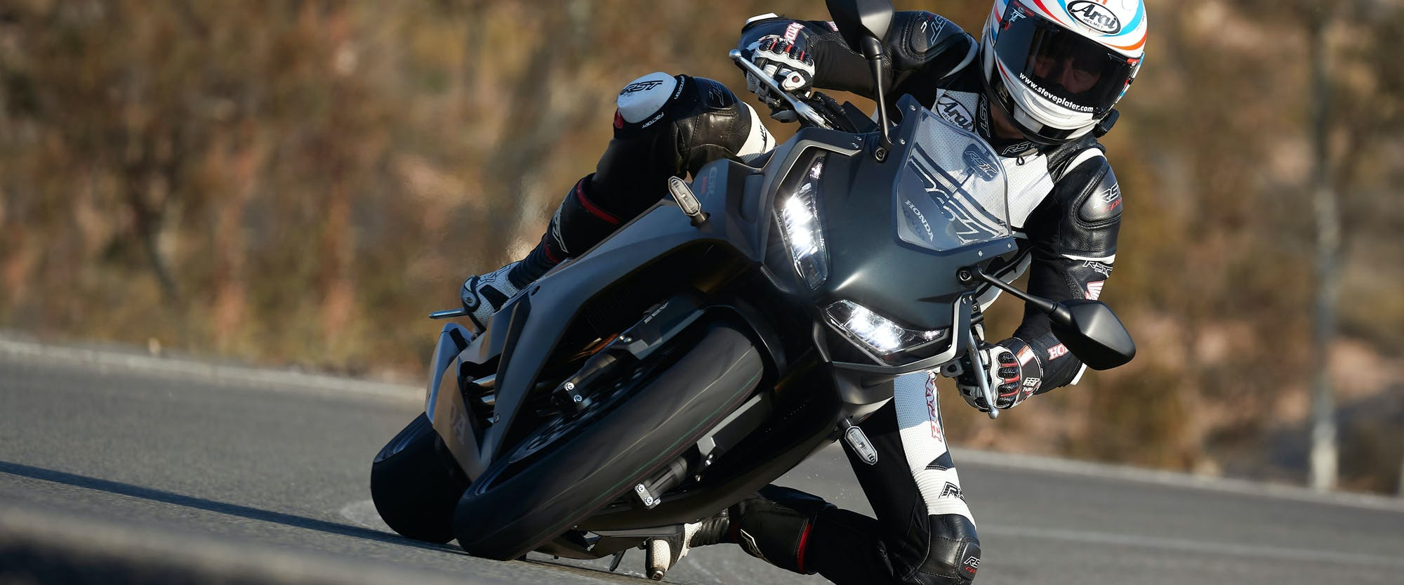 Honda CBR650R in pearl smoke grey colour, being ridden on the road