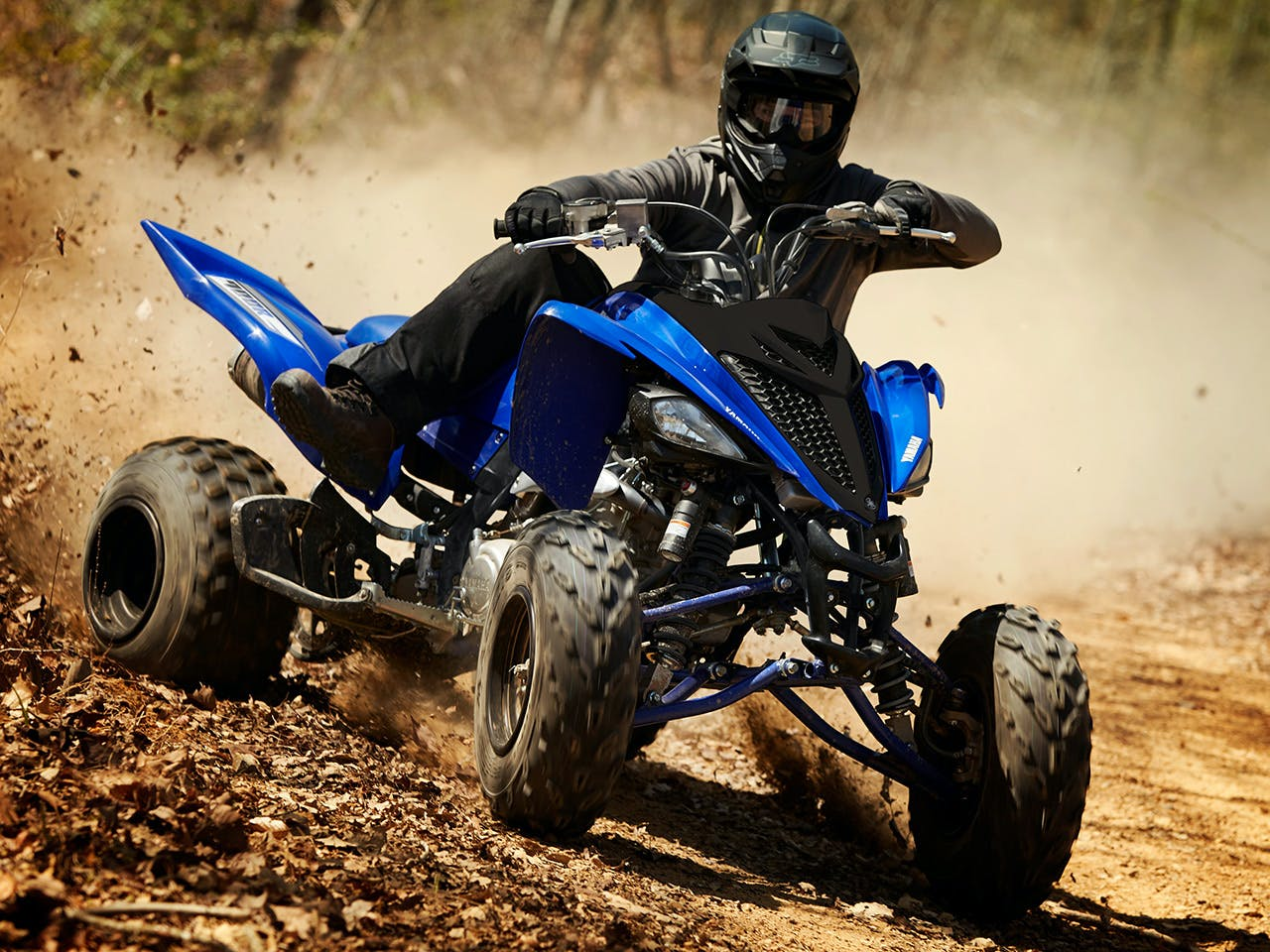 Yamaha YFM700R in team yamaha blue colour, being ridden off-track