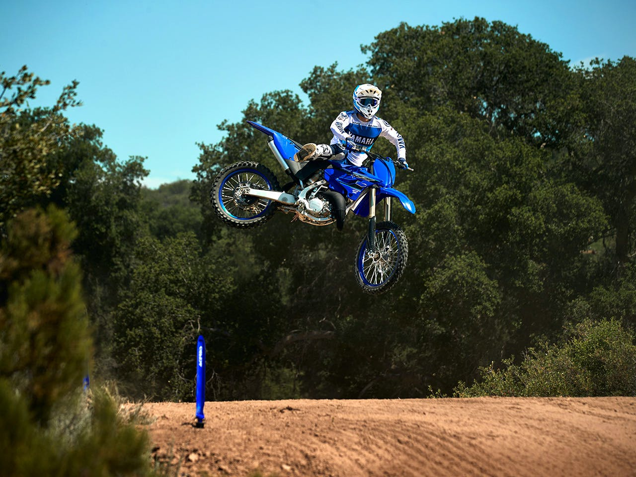 Yamaha YZ125 in team yamaha blue colour, being ridden off-track