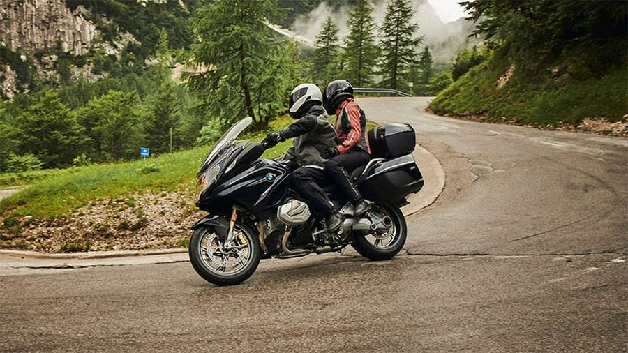 BMW R 1250 RT Option 719 being ridden on a hill road