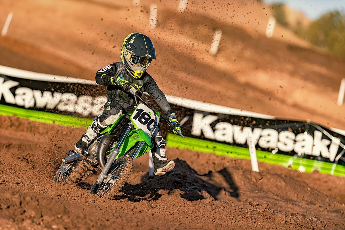 KAWASAKI KX65 in lime green colour on off-road track
