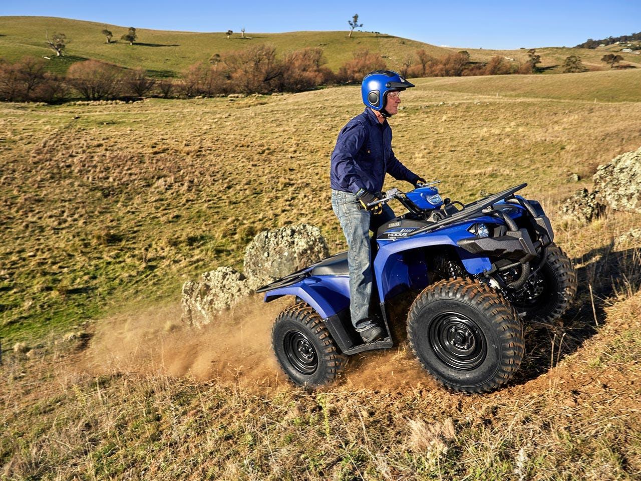 Yamaha Kodiak 450 EPS riding on a dirt track